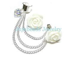 White Rose Swarovski Heart Chain Ear Cuff sold by Pretti Jewels. Shop more products from Pretti Jewels on Storenvy, the home of independent small businesses all over the world. Ear Chain, Anniversary Jewelry, Natural Stone Jewelry, Cuff Earrings, Swarovski Crystals, Fine Jewelry, Jewelry Making, Rose, Ear Cuffs