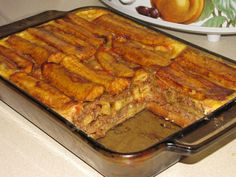 These 18 Traditional Dishes Prove That Puerto Rico Has The Best Food What is it: Sweet plantains mashed together and layered with ground beef much like lasagna. Conclusion: Add pastelón to your bucket list. Puerto Rican Dishes, Puerto Rican Recipes, Mexican Food Recipes, Beef Recipes, Cooking Recipes, Pasteles Puerto Rico Recipe, Puerto Rican Lasagna, Puerto Rican Pasteles, Desert Recipes