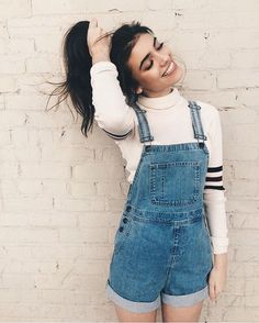 blue overalls + sweater More