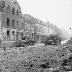 British Tanks advance through the Reichswald during Operation 'Veritable', 8…