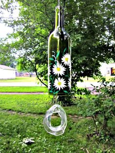 Wind Chime Recycled Wine Bottle Green Bottle Hand Painted White Flowers via Etsy