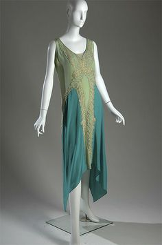 """Callot Soeurs    Evening gown, c. 1928  Silk charmeuse, pearl, metallic thread    Although the Callot Soeurs are almost forgotten today, their most illustrious protégé Madeleine Vionnet regarded them as outstanding dressmakers, far superior to Chanel. Vionnet once said, """"Without the example of the Callot Soeurs, I would have continued to make Fords. It is because of them that I have been able to make Rolls-Royces.""""    This gown is one of more than 60 couture pieces featured in the exhibition…"""