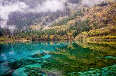 A morning view of the Five Colour Lake, Jiuzhaigou Valley Natural Park, Sichuan province,… - Holy Kaw!