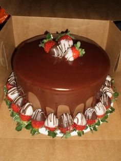 triple chocolate cake with chocolate covered strawberries By dguerrant on CakeCentral.com