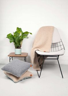 Granny's FInest | Dutch design, the plaid and pillows are handknitted by Dutch elderly