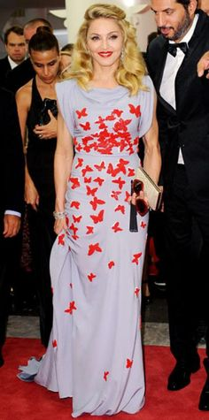 Look of the Day › September 2, 2011 WHAT SHE WORE Madonna struck a pose at the Venice Film Festival in a silk satin Vionnet fishtail gown.  WHY WE LOVE IT Butterflies were a fitting choice for the ever-changing star. The W.E. director's beaded design also paid homage to her film, which includes costumes based on the Madeleine Vionnet archive.