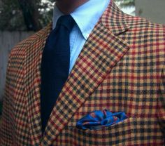 Brown and red guncheck blazer, navy tie, light blue button down shirt, bright blue silk p square, casual Friday