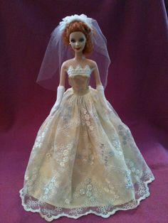 Beautiful vintage barbie wearing a handmade wedding gown veil and gloves via Etsy