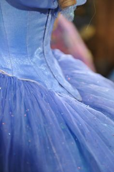 Can juuuust see that it's closed with hooks and eyes. The fabric for the bodice is so strange. It reads as smooth satin in the movie, but up close it has shiny texture of some sort, plus it changes color shading from blue to purple depending on the direction of the fabric.