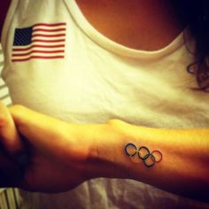Olympic rower Sarah Zelenka Olympic rings tattoo! ❤ liked on Polyvore featuring accessories and body art