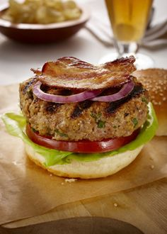BLT Turkey Burger - The cheddar cheese is mixed right in with the ground Ontario turkey creating a moist, flavourful burger that holds together well on the grill. Top with crisp Ontario bacon, lettuce and tomato and serve with a side salad or slaw for a quick and easy weeknight dinner the whole family will enjoy!
