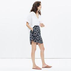 """A pull-on mini with a sleek curved hem. Made of so-soft brushed silk in a fresh take on a timeless batik print, this skirt will keep you cool in all kinds of ways. <ul><li>Short, straight skirt.</li><li>18 1/4"""" long.</li><li>Silk.</li><li>Dry clean.</li><li>Import.</li></ul>"""