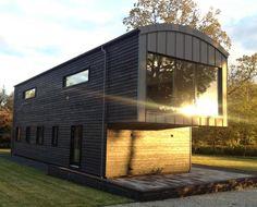 A sustainable energy efficient, Para 55 Passivhaus, that utilizes the latest renewable technology. Garage Design, Exterior Design, House Design, Carbon Sequestration, Chic Beach House, Architecture Sketchbook, Roofing Systems, Natural Building, Garden Buildings