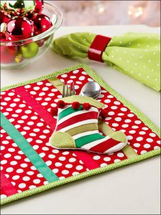Love these fun table mats. the stocking cutlery holder is so funky