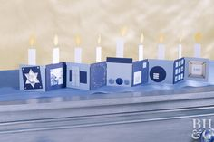Unfold the joy of the season with this menorah-inspired accordion card for your mantel or tabletop. Decorate blue and navy squares with sliver accents, buttons, and wire. Fun Stuff, Stuff To Do, How To Celebrate Hanukkah, Hanukkah Decorations, Hanukkah Menorah, Tabletop, Birthday Candles, Banners, Squares