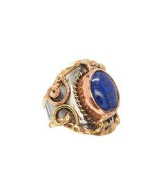 Delicious lapiz lazuli boasts a bold dose of sheen atop a chunky mixed-metal ring for a dash of free-spirit allure.