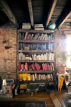 Bookshelf..my OCD kicked in when I saw the books colored coded! Love the natural wood used for this bookshelf!