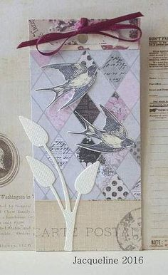Using snippets of paper, a diecut and two swallows finishing touch a burgundy ribbon to create this tag.
