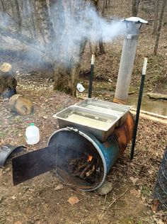 Wood-burning homemade extractor - 55 gal metal drum with a chimney