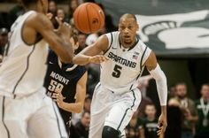 Adreian Payne passes the ball to senior guard Keith Appling during the game against Mount St. Mary's on Nov. 29, 2013, at Breslin Center. The Spartans defeated the Mountaineers, 98-65. Khoa Nguyen/The State News