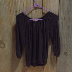 Micheal Kors Top Cute, classic black top. 3/4 sleeves. There is elastic and the edges of sleeves and bottom of shirt. MICHAEL Michael Kors Tops