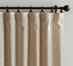 oatmeal color, single width, blackout lining, on black rod as pictured                                Emery Linen/Cotton Drape | Pottery Barn