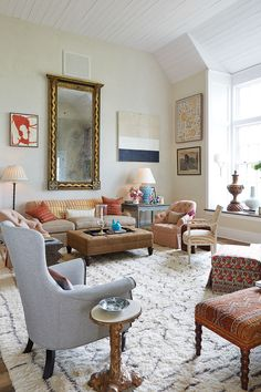 We loved the spicy color palette in the living room of the 2015 Southern Living Idea House -- warm corals, tan, and oranges.