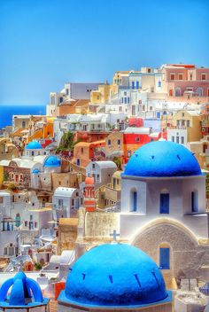 Colourful houses on Santorini - Greece. I believe that Santorini is the lost city of Atlantis Places Around The World, The Places Youll Go, Travel Around The World, Places To Visit, Around The Worlds, Dream Vacations, Vacation Spots, Beautiful World, Beautiful Places