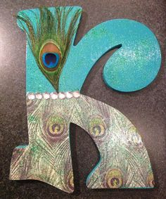 Peacock Letter K