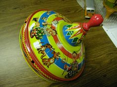 antique toys | ... toy top measuring 9 in diameter this authentic antique tin toy top was