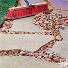 Fill gaps between flagstone pavers with decorative landscape rock, which is less messy than sand and more stable than pea gravel. Use graduated sizes (to ensure they fit together well) that are 1 inch or smaller in diameter. Use a large broom to help spread the rocks around. #WalkwayLandscape
