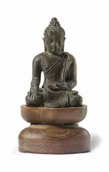 A Bronze Figure of a Seated Buddha Java, 12th century 2 ½ in. (6.4 cm.) high