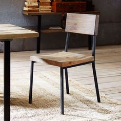 Deep textured planks of mindi wood are supported by steel frame that give the Ink+Ivy Tacoma dining chair a warm vintage feel. The Metal powder coated frame is in a black finish. The seat and back are solid wood are in a natural variant finish.
