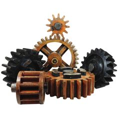 Group of Six English Wooden Cog Moulds | From a unique collection of antique and modern wall-mounted sculptures at https://www.1stdibs.com/furniture/wall-decorations/wall-mounted-sculptures/