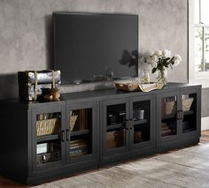 A stylish, contemporary TV stand with square molding and inset drawer pulls will look great in addition to providing storage space for media players and DVDs.