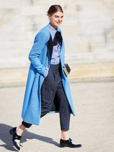 Pair a casual blouse and flats with a statement overcoat.