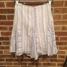 Intuitions skirt with stripes Light weight super comfortable. A great skirt for warm wether. Blue, white, cream and grey stripes with little silver sparkles. Size 8. Skirts