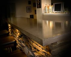 the details of a basement bar. Lighting and stone and countertop