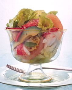Lobster Salad with Grapefruit, Avocado, and Hearts of Palm. Dressed with a Dijon/lemon basil vinaigrette. I want this! But I'm not cooking the lobsters myself.