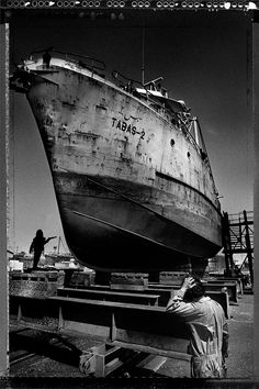 Taken in the Jaddaf ship yard. Love the superman like figure sand blasting the ship with the indian worker scratching his head. Dubai, approx. 1995/1996