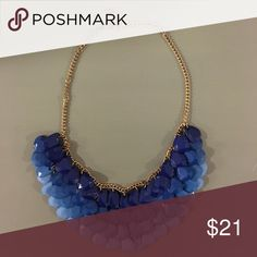 Shades of Blue Statement Necklace Statement necklace on gold chain. A fun way to mix it up and dress up a plain outfit. All pieces are in tact. Jewelry Necklaces