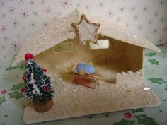 I need to make one of these for my Nativity statues! Christmas Village Putz Nativity Stable