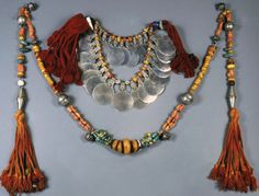 Morocco | a) Berber woman's necklace in silver, amber and shell from Tiznit and B) Berber necklace with sash in amber coral amazonite from the southern region.