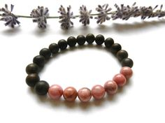 I have made this beautiful unisex bracelet using 7 Rhodonite Beads (8 mm) and Vietnam Aquilaria Beads (8 mm).  It is very natural and organic looking