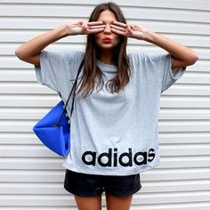 baggy retro adidas tee, black shorts and triangle sports bag