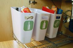 DIY under cabinet recycling bins--use any bin of your choice that fits under the sink, print off these decals for free. Perfect for our small space!
