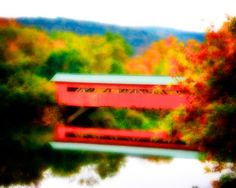 There is something romantic about the image of a covered bridge. They always bring up images of a rustic world gone by. Combine the fall colors in this image with the bridge over the river and it draws you in. It's a relaxing piece of art that lets you drift into it and wonder about that world of an era gone. This piece has something for both the fall art collector and the bridge enthusiast of any house.