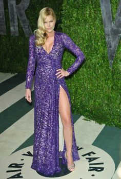 Model May Andersen attended the 2012 Vanity Fair Oscar Party at Sunset Tower on February 26, 2012 in West Hollywood, California in a stunning purple sequin Abed Mahfouz Spring/Summer 2012 Ready-to-wear evening dress.