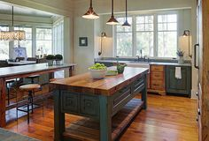 Rustic Cottage with Neutral Interiors- Kitchen; Fantastic farmhouse table-style kitchen island, (with a butcher block counter top), is a big and heavy piece that anchors the entire kitchen.