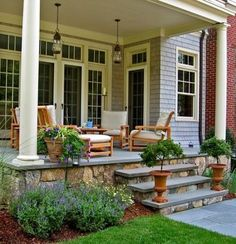 lighting, stone steps and porch skirting So pretty! @Lisa Roussel ideas for decorating your new patio?